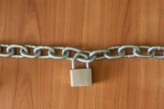 Łańcuchy na drewnianym tle Obraz Stock