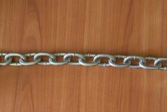 Łańcuchy na drewnianym tle Zdjęcie Stock