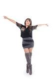Łacińska dziewczyna jest ubranym suknię i buty pozuje z obraz royalty free