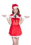 Ładna Azjatycka dziewczyna w Santa kostiumu dla bożych narodzeń na białym backgr Obraz Royalty Free
