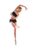 Ładna balerina pozuje pn białego tło w szkolenie kostiumu Zdjęcia Stock