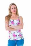 Ładna blondynka nieszczęśliwa z rękami krzyżować Obrazy Stock