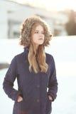 Ładna blondynka w zimy kurtce Obrazy Royalty Free