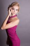 Ładna blondynki kobieta w koktajl sukni fotografia stock