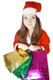 Ładna dama ubierająca jako Santa z teraźniejszość Zdjęcie Royalty Free