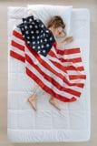 Ładna dobra przyglądająca chłopiec ma patriotycznych sen Obraz Stock