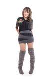 Ładna dziewczyna jest ubranym mini suknię pozuje z rękami obraz stock