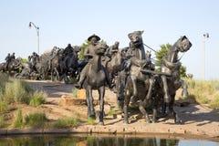 Ładna grupowa brązowa rzeźba w Centennial ziemi Biega zabytek zdjęcia royalty free
