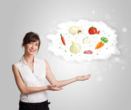 Ładna kobieta przedstawia chmurę zdrowy odżywczy warzywo ilustracji