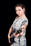 Ładna kobieta z gitarą Zdjęcia Stock