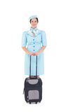 Ładna lotniczej gospodyni domu mienia walizka Obrazy Royalty Free