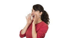Ładna młoda dziewczyna jest ubranym czerwonego wierzchołek pozuje krzyczeć Obrazy Royalty Free