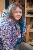Ładna młoda dziewczyna siedzi w krześle wszystko ubierającym up dla Wielkanocnych wakacji Obrazy Royalty Free