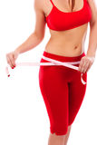 Ładna młoda kobieta mierzy jej ciało, zdrowy stylu życia concep Obrazy Stock
