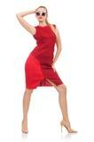 Ładna młoda kobieta w czerwieni sukni odizolowywającej na obrazy royalty free