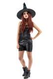 Ładna młoda rudzielec czarownica, odizolowywająca przeciw białemu tłu Obraz Royalty Free