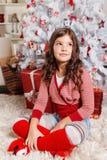Ładna mała dziewczynka przy bożymi narodzeniami Obrazy Stock