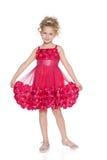 Ładna mała dziewczynka w czerwonej sukni zdjęcie royalty free
