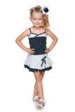 Ładna mała dziewczynka w mody sukni fotografia stock