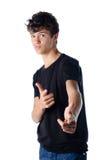 Ładna nastolatek chłopiec w chłodno pozie odizolowywającej zdjęcia stock