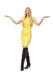 Ładna uczciwa dziewczyna w kolor żółty sukni odizolowywającej na bielu Obrazy Royalty Free