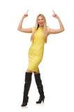 Ładna uczciwa dziewczyna w kolor żółty sukni odizolowywającej na bielu Fotografia Stock