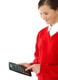 Ładna uczennica używa kalkulatora obrazy stock