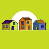 Ładni domy ustawiający z żółtym tłem Zdjęcie Stock