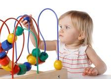 Ładny dziecko z kolor edukacyjną zabawką Obrazy Royalty Free