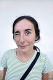Ładny kobieta kogut one oko przy Obraz Royalty Free