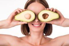 Ładny młodej kobiety mienia avocado Obraz Stock