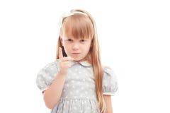Ładny małej dziewczynki mienia palec przed twarzą Zdjęcie Stock