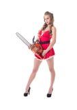 Ładny model ubierający jako Santa reklamuje piłę łańcuchową obrazy royalty free