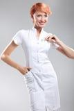 ładny pielęgniarki pigułek pokazywać fotografia royalty free