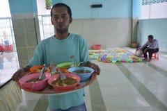 Łamać szybko z owsianką w meczetowym Pekojan Semarang Zdjęcia Stock