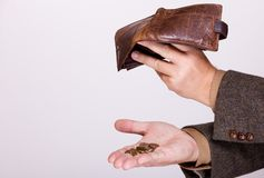 Łamał biznesmena z pustymi portfla i połysku monetami Obraz Stock