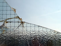 Łamający frosted szklany okno Zdjęcia Stock