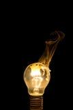 Łamany żarówka oparzenie out z płomieniem Obraz Stock
