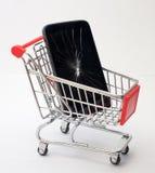 Łamany smartphone w zakupy tramwaju przeciw jako tła popasu pojęcia dolarom szarość wiesza haczyka Brakowi towary obraz royalty free