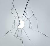Łamany szkło na białym tle z dziurą obraz royalty free