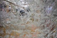 Łamany szkło w pęknięciach dla tło wizerunku obraz stock