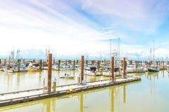 Łodzie i doki przy Steveston rybaka ` s nabrzeżem obraz stock