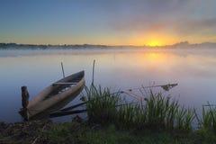 Łodzie przy wschód słońca Zdjęcia Stock