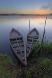 Łodzie przy wschód słońca Obrazy Stock