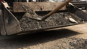 Łopaty rzuca asfalt zdjęcie wideo