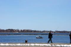 Łowić i wioślarska łódź Zdjęcie Stock
