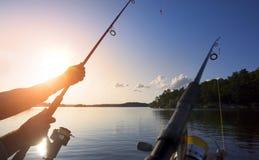 Łowić przy zmierzchem Zdjęcia Royalty Free