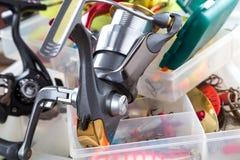 Łowić rolkę na pudełkach z wabije i wobblers Fotografia Stock