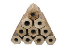 Łupka naciskający trociny w postaci dudniących butli heksagonalnego kształta obrazy stock
