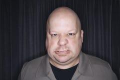 łysy człowiek szydzić zdjęcia stock